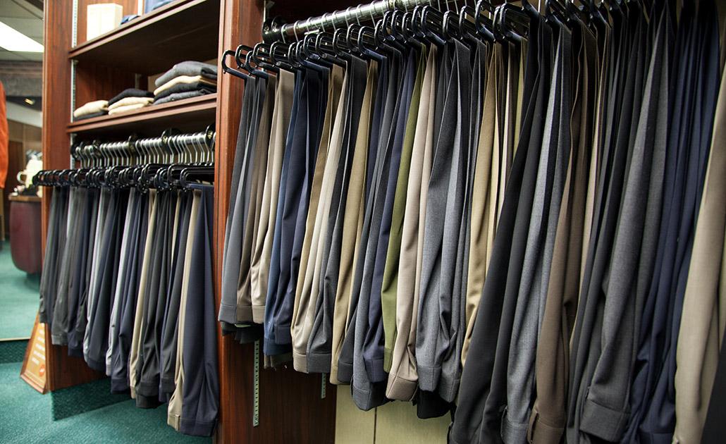 Mens dress pants hanging on a rack