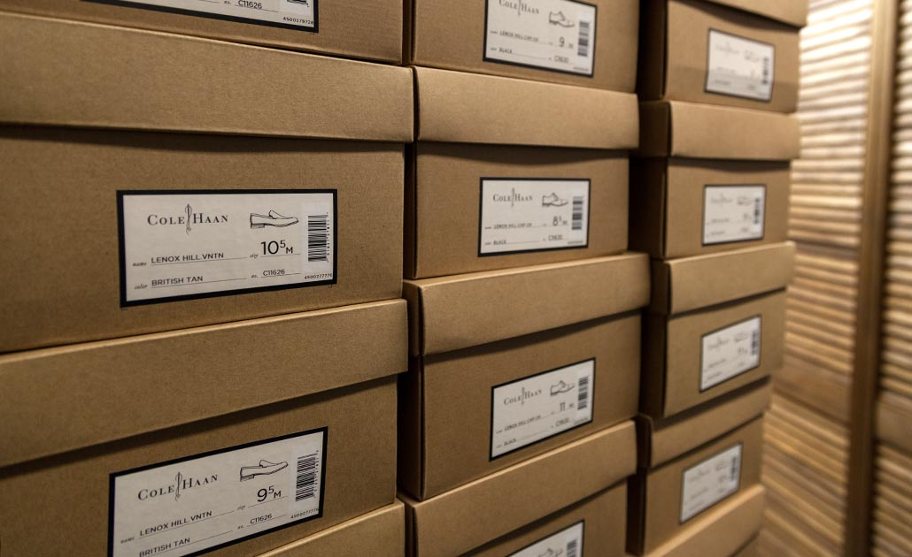 Cole Haan shoes stacked in our storeroom
